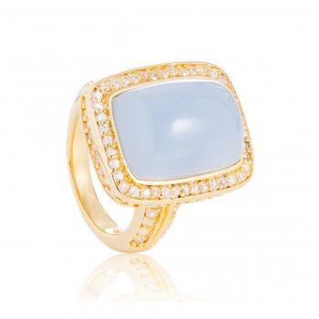 Ingenious gold ring with rectangle blue stone and pave surround