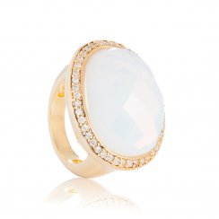 gold ring with oval moonstone and pave surround
